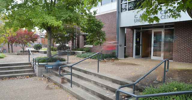 image of the University Center entrance with trees in the foreground