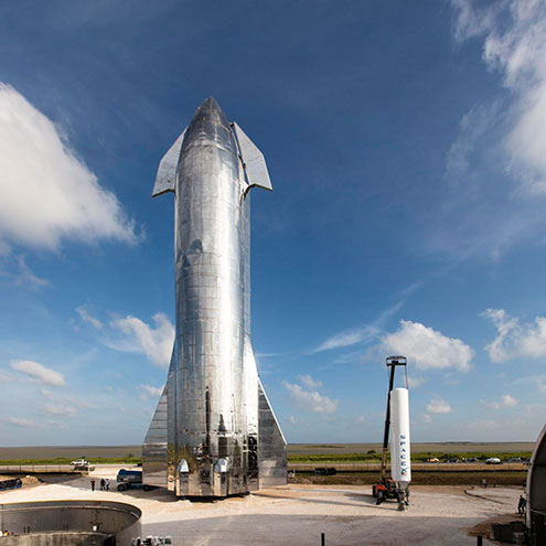 SpaceX Starship next to Falcon One Source( https://www.space.com/spacex-starship-reach-orbit-six-months.html)
