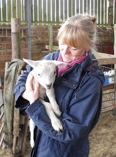 The author holding a white lamb