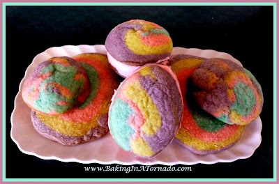 Spring Fever Cookies, beautiful round or egg shaped multicolored sandwich cookies with a little sweet filling inside | Recipe developed by www.BakingInATornado.com | #recipe #cookies