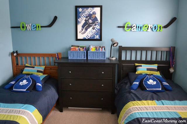 hockey bedroom. They have matching bedding  but I labelled each side with a hockey stick containing of their names You can find step by tutorial for the East Coast Mommy Shared HOCKEY BEDROOM on budget Revealed