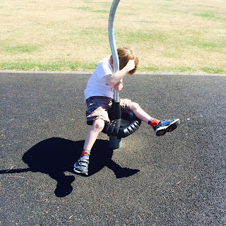 Our autistic son, at the playground