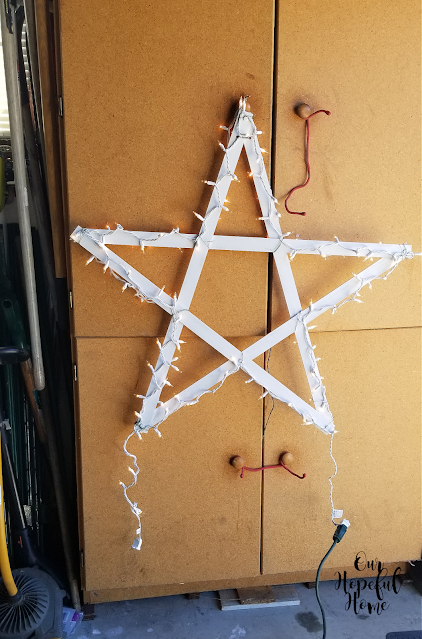 white painted large wooden star CHristmas light strand