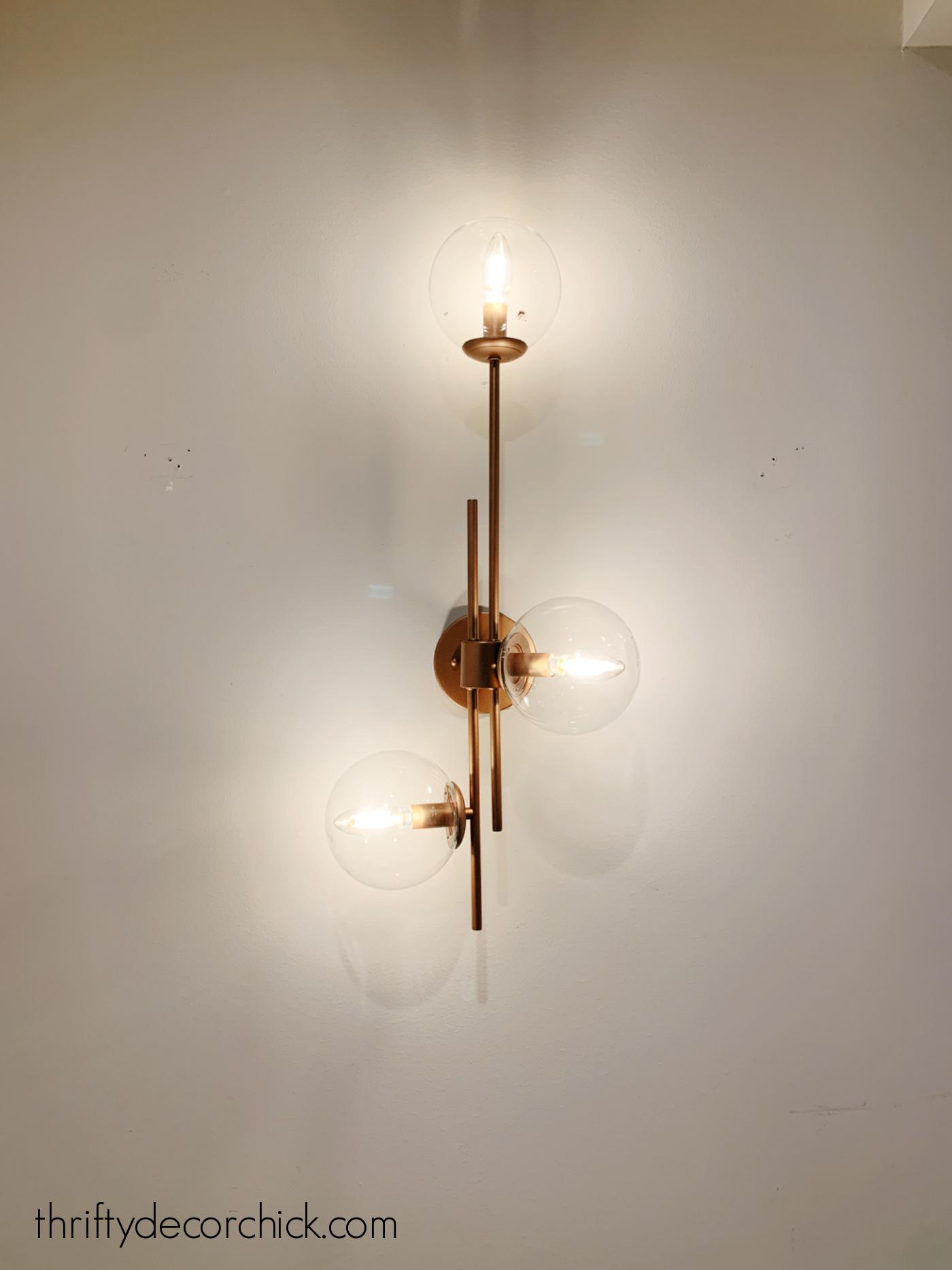 Lowe's Ellan three globe light sconce