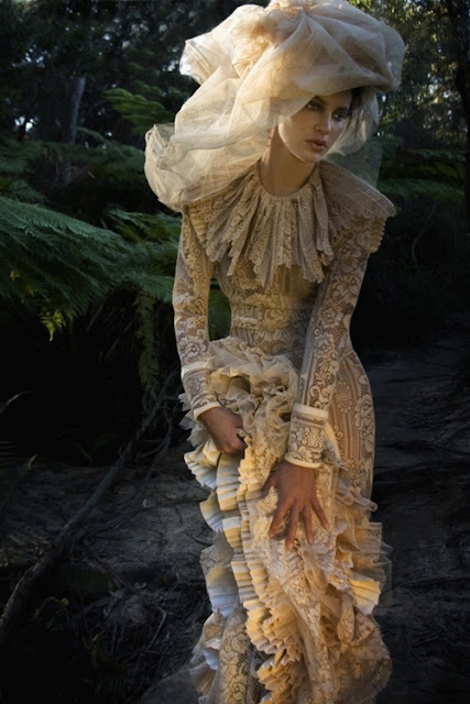 Victorian bride in cream lace wedding dress with stylized veil