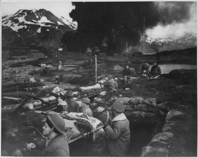 Marines waiting out the bombing of Dutch Harbor, 3 June 1942 worldwartwo.filminspector.com