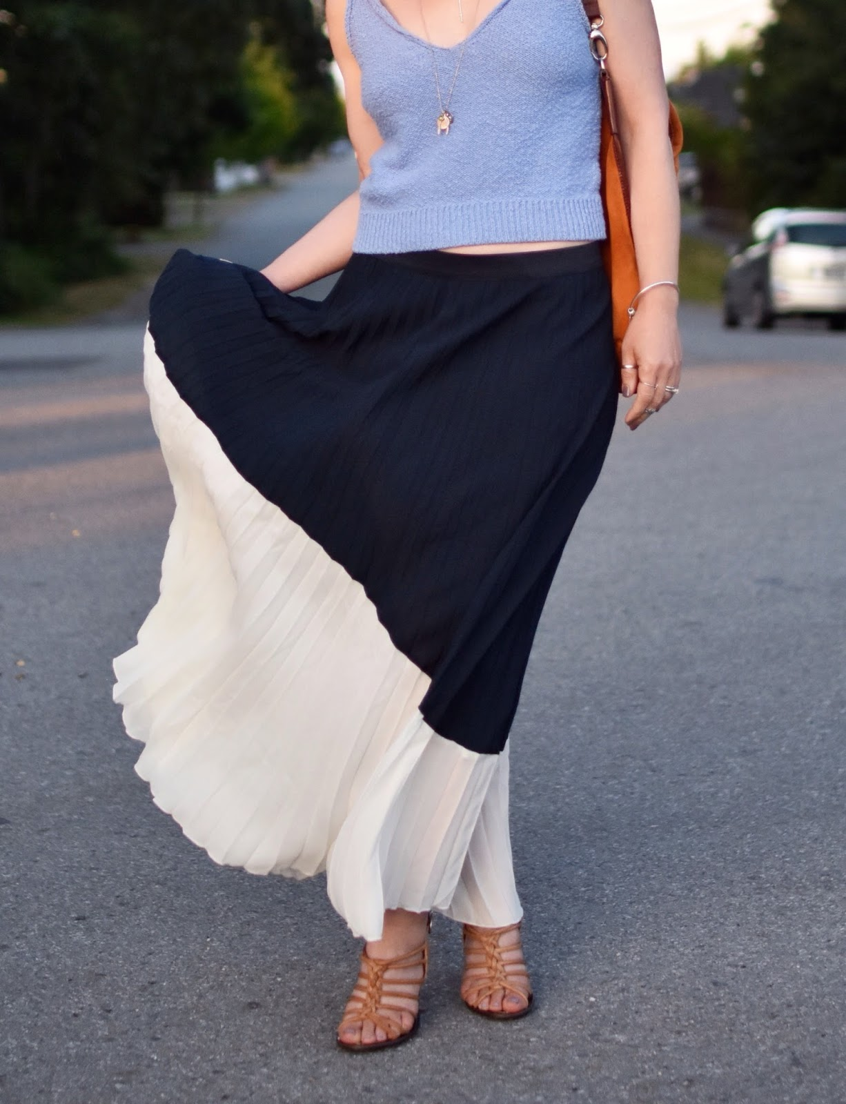 Monika Faulkner personal style inspiration - pleated asymmetrical skirt, strappy nude sandals