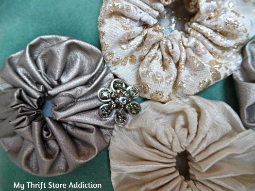 """Recreate Your Pillows: A Holiday Fashion Show mythriftstoreaddiction.blogspot.com No sewing required--just pin on a vintage brooch and """"button"""" on quilt yo-yos for a new look"""