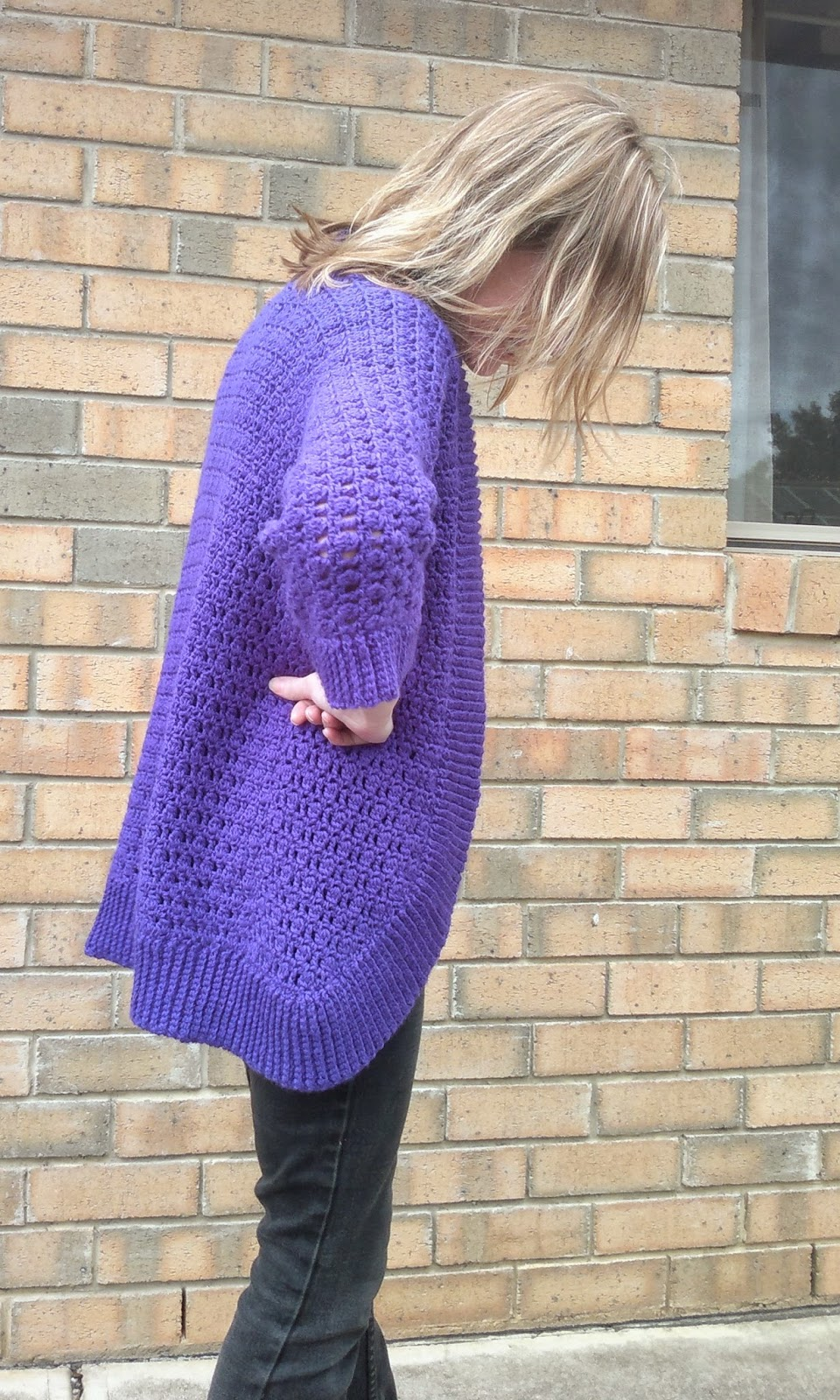 The right hand side view of the Belcarra cardigan modelled by Jodie.