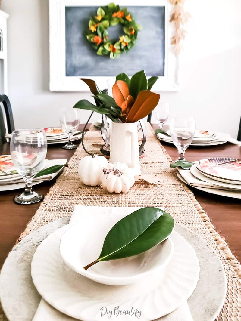 fall dining room with magnolia leaves