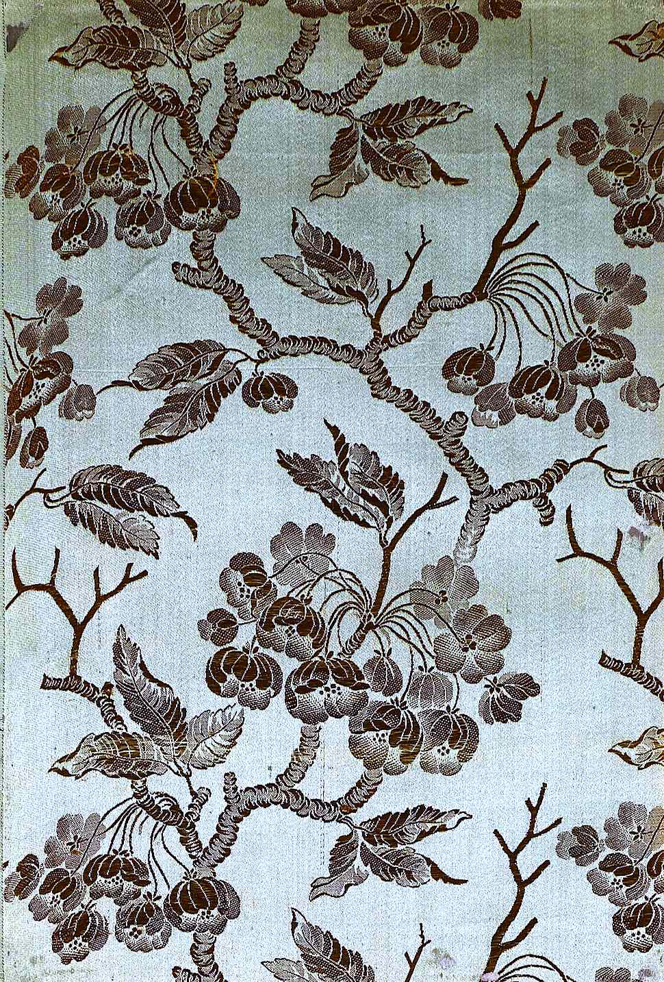 1700 silk with tree blossoms, a color photograph