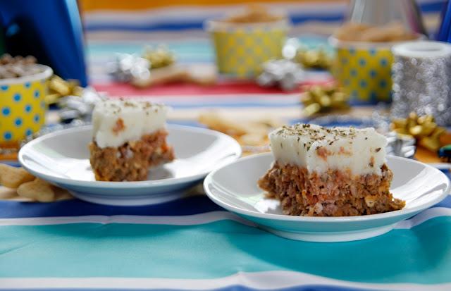 Homemade meatloaf dog birthday cake sliced on plates