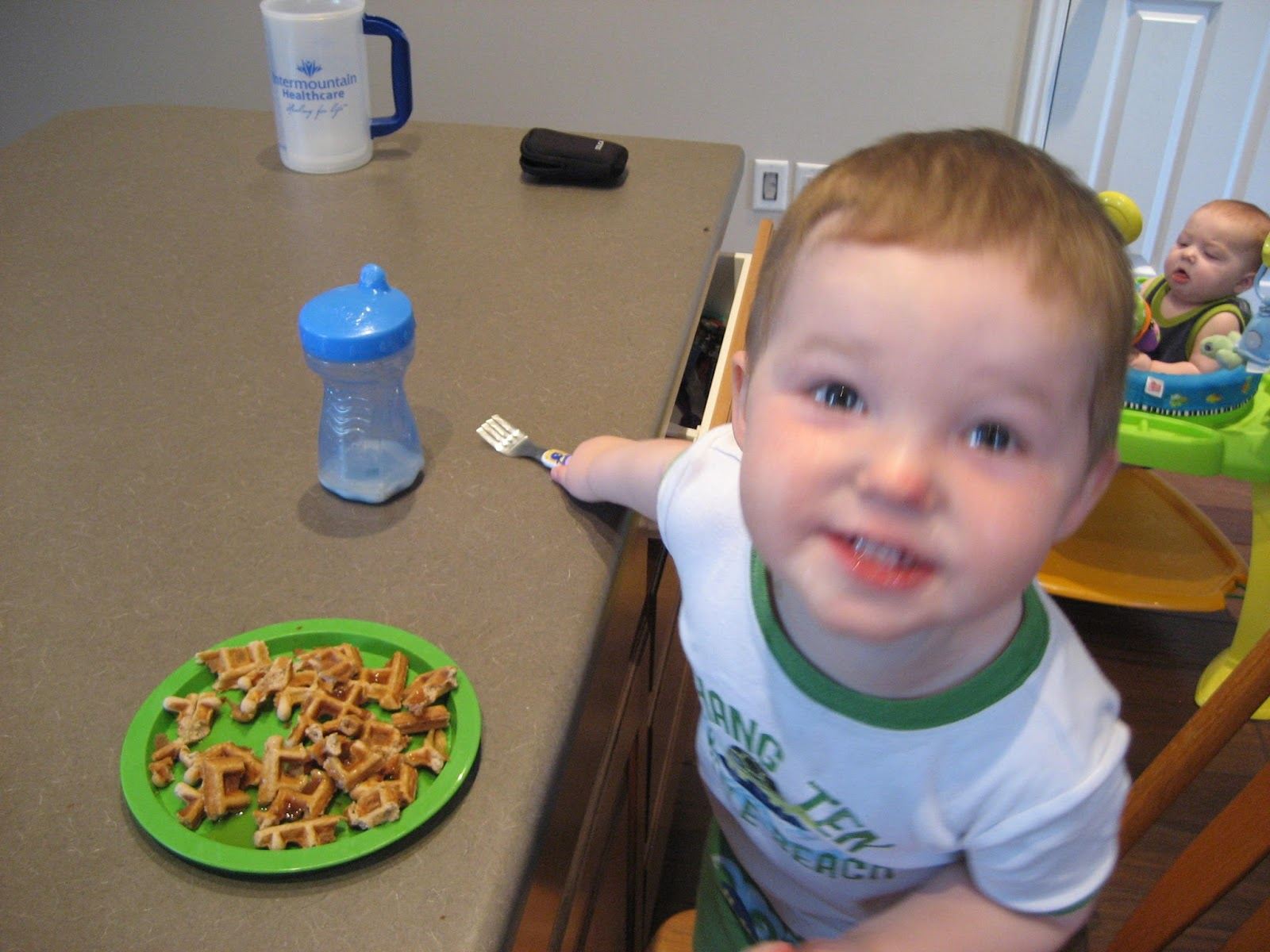 Dinner in the Life of a Dad—Coconut Flour Waffles. another picture of my son smiling while eating the waffles