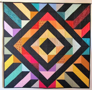 Amish log cabin quilts