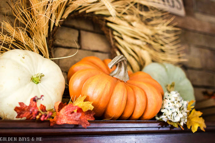Fall mantel ideas with pumpkins and straw wreath - www.goldenboysandme.com