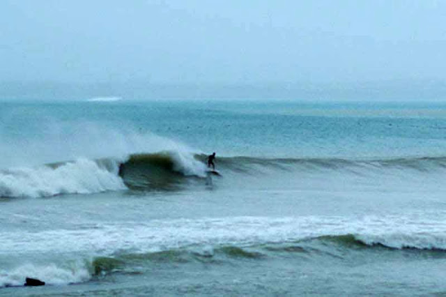a surfer taking advantage of waves
