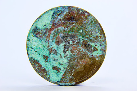 corroded copper penny