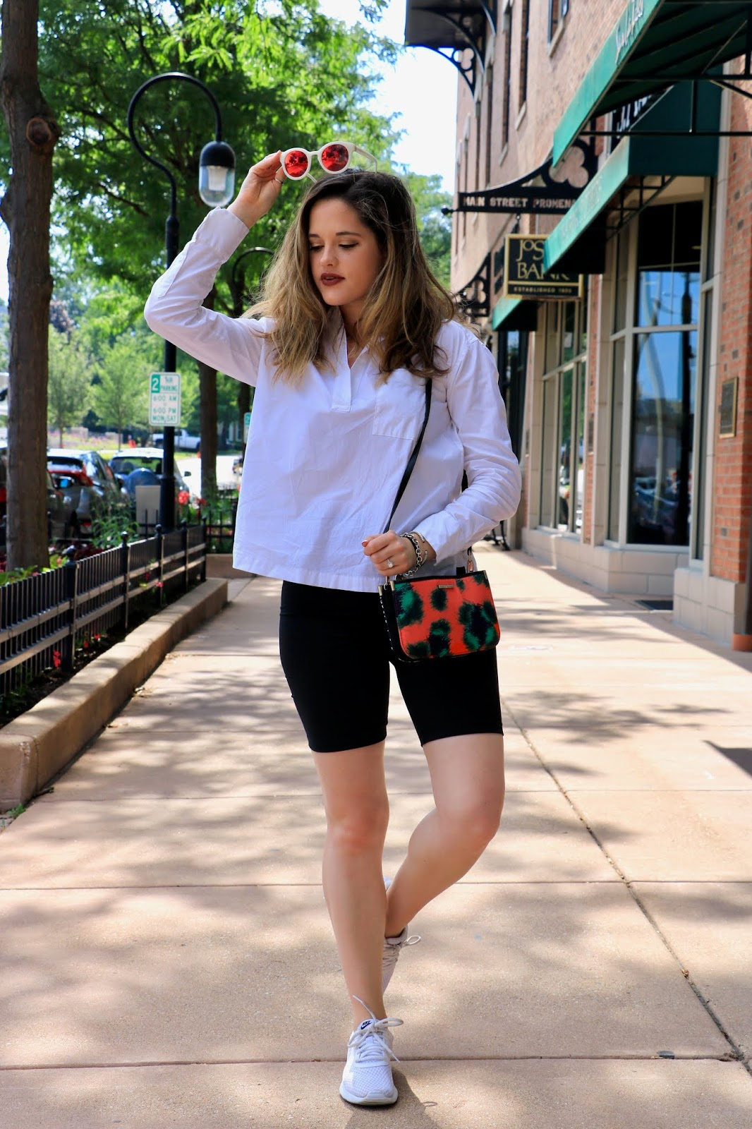 Nyc fashion blogger Kathleen Harper wearing an easy summer 2019 outfit of bike shorts and sneakers.