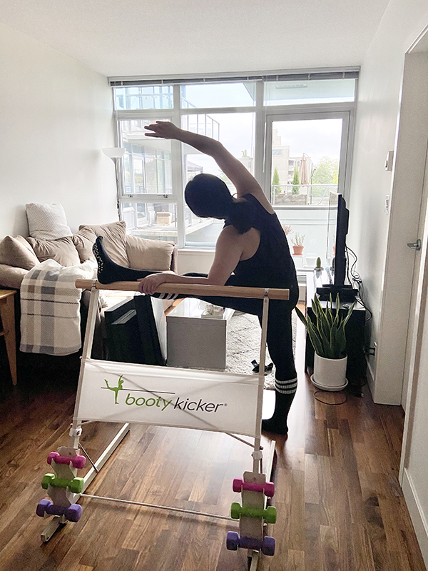 Vancouver beauty, life and style blogger Solo Lisa stretches at the Bootykicker portable barre.