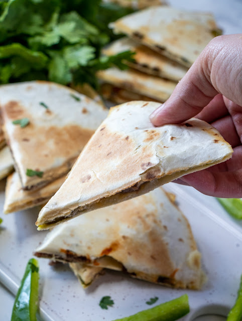 Hand holding Philly Cheesesteak Quesadillas