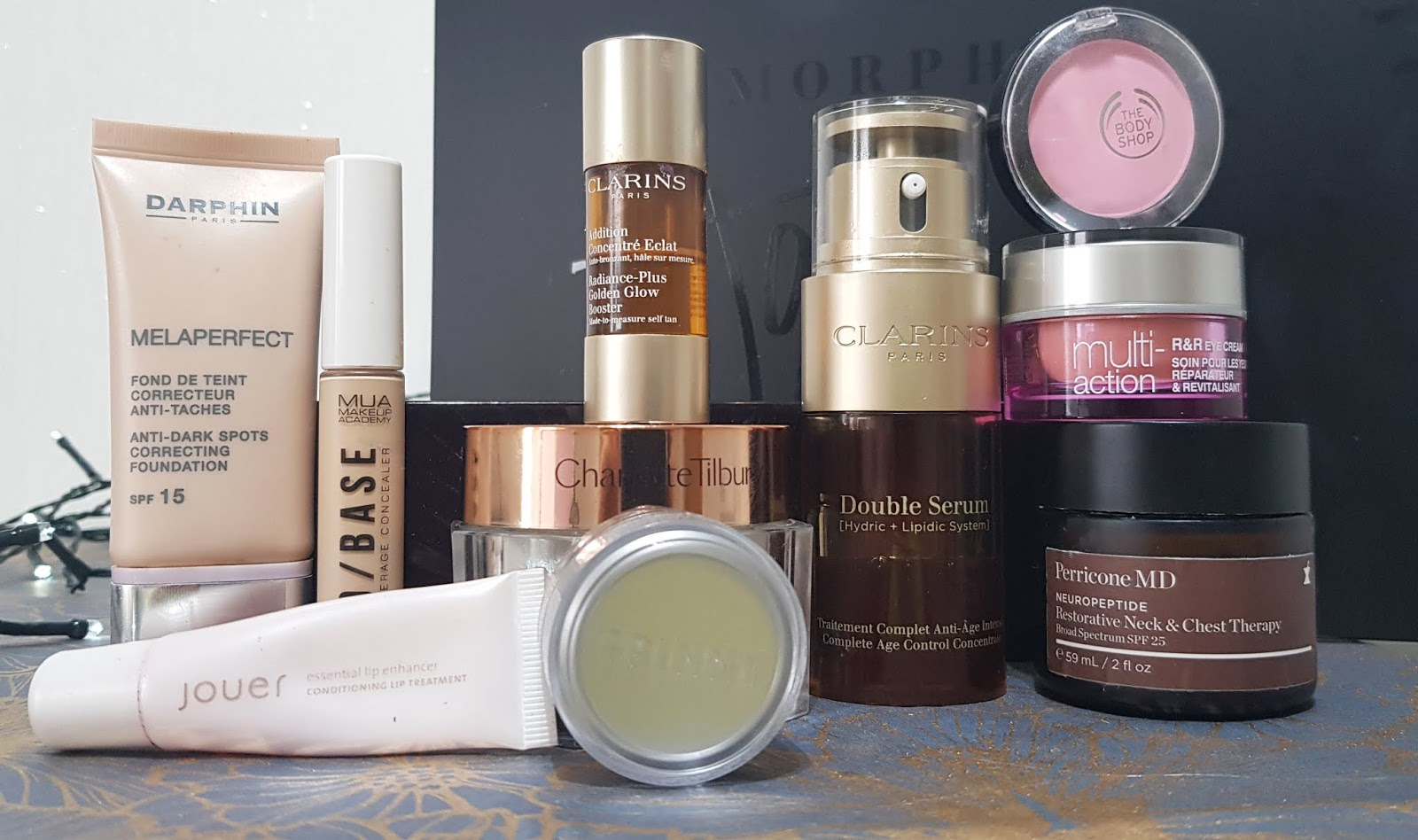 Several skincare and makeup products being used by Is This Mutton blogger Gail Hanlon including a foundation to cover pigmentation and a face cream, neck cream and eye cream to help over-50 skin