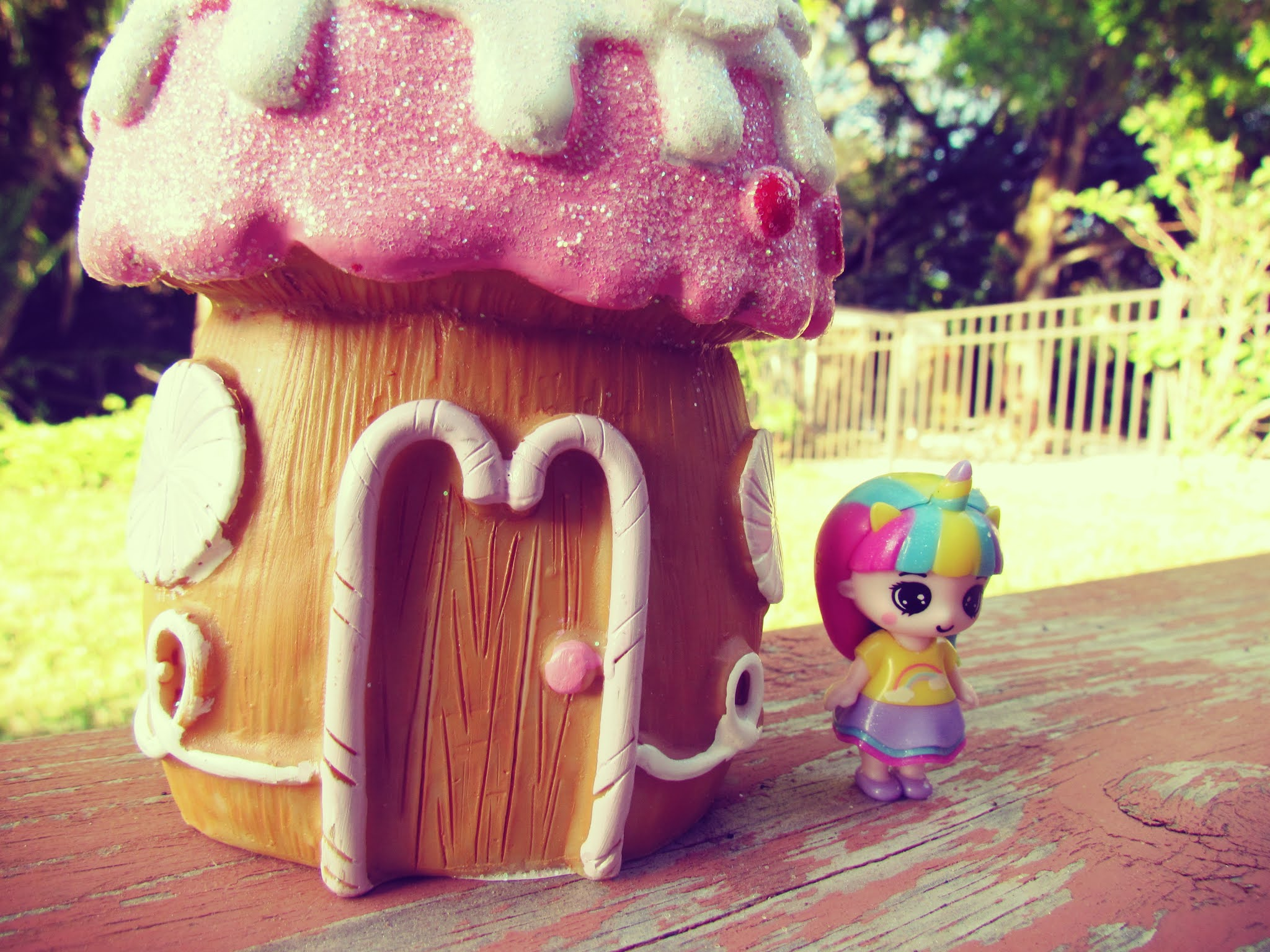 Mystical fairy village with rainbow-haired unicorn doll with magical unicorn horn to unlock magic powers and mysticism