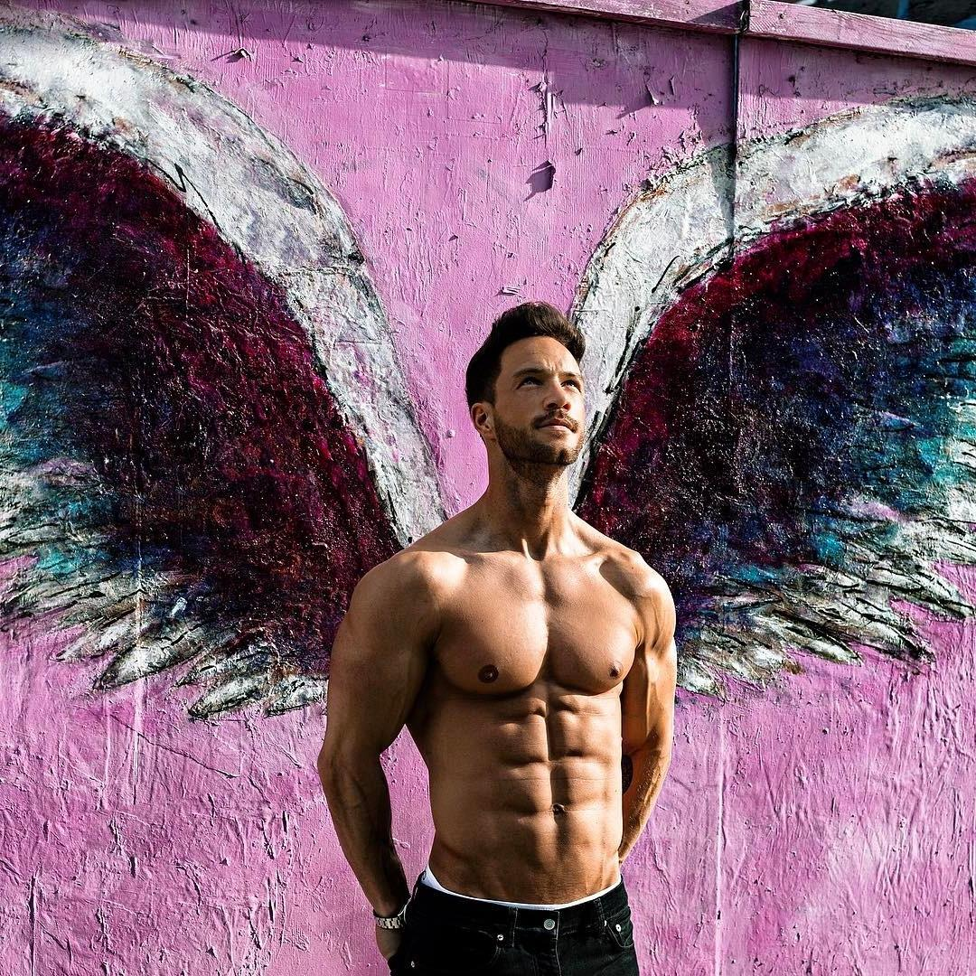handsome-bare-chest-fit-man-sixpack-abs-round-pecs-biceps-bearded-daddy-angel-wings-wall-graffiti