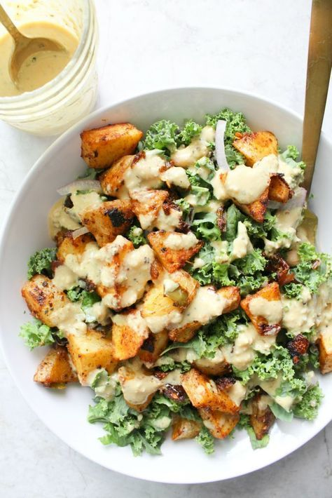 These Spicy Potato Kale Bowls with Mustard Tahini Dressing are the perfect Fall meal. Crispy potatoes, red onion, marinated kale and a delicious creamy dressing. Simple and healthy.