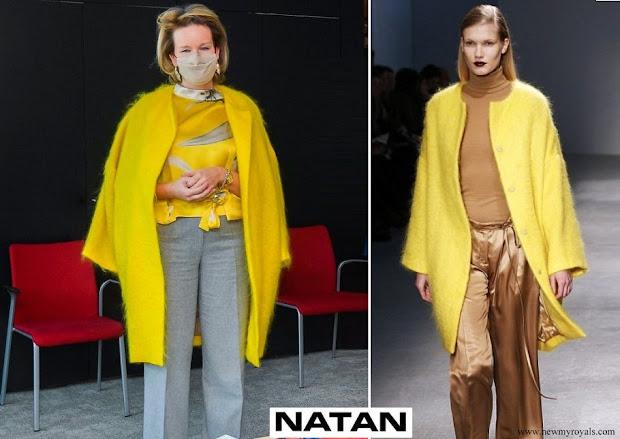 Queen Mathilde wore a yellow coat from Belgian designer Edouard Vermeulen of Natan