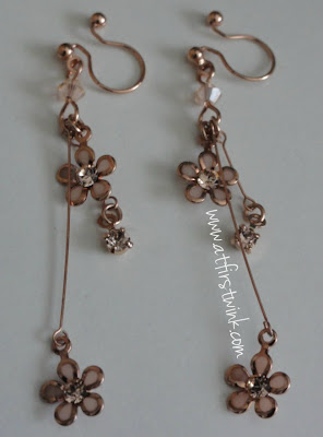 It's Demo rose gold flower earrings