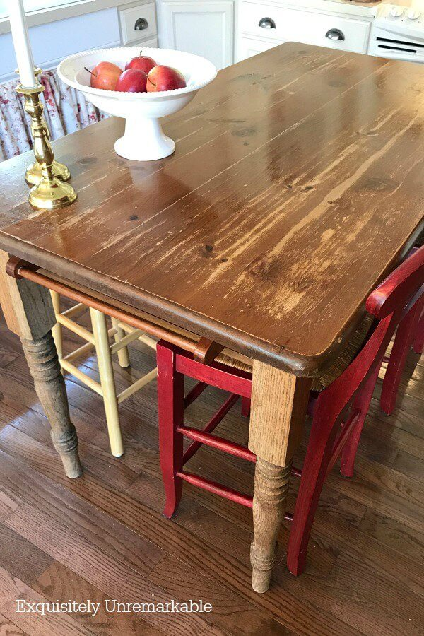 Wooden table with damage and wear spots in the kitchen