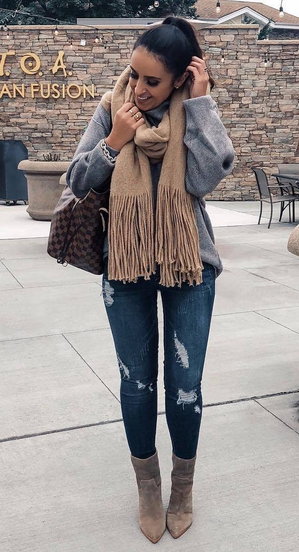 what to wear with a scarf : grey sweater + plaid bag + rips + brown boots