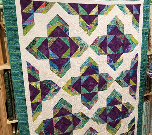 Lotus Blossom Quilt Free Tutorial designed by Cozy Quilt Designs for Jordan Fabrics