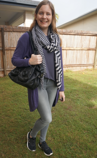 moncohrome grey tee and skinny jeans sneaker outfit with black white scarf and button bag and purple cardigan