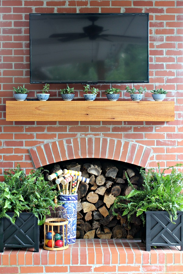 outdoor fireplace, brick fireplace, outdoor living area, croquet, stacked log fireplace, tv over fireplace