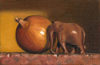 Still life oil painting of a small, carved wooden elephant beside a brown onion.