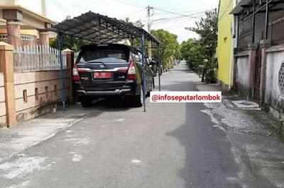 Heboh, Mobil Plat merah bikin garasi pinggir jalan. Ini aturan parkir mobil yang harus diketahui.