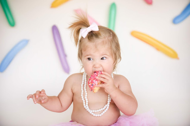 baby eating donut instead of cake