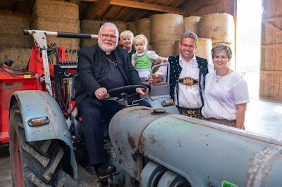 Cardinal Marx on a tractor