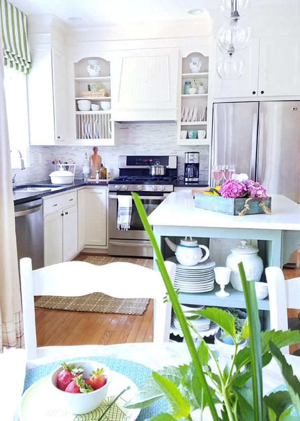 coastal kitchen  green roman shade - open cupboards