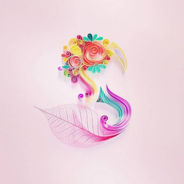 quilled letter S resembling swan with skeleton leaf accent