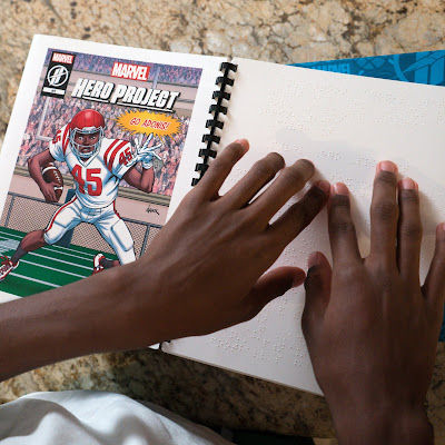 Photo of Adonis' hands reading the braille version of Unstoppable Adonis comic book, featuring an illustrated image of Adonis in his football uniform running with the ball.  Call out box reads: Go Adonis