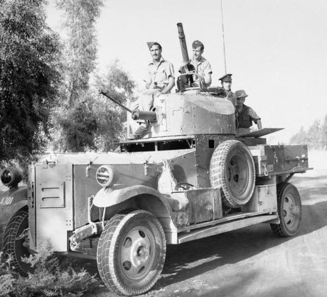 486678a666 Fordson Armoured Car of No. 2 Armoured Car Company RAF waits outside  Baghdad