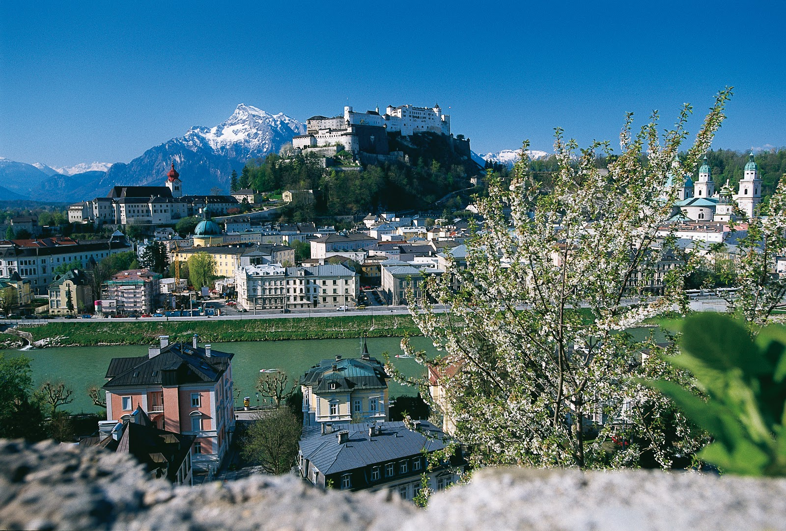Beyond the Hohensalzburg Fortress, behold Untersberg Mountain, the location of the final scene in the movie when the Von Trapps were crossing over the mountains into Switzerland. © Tourismus-Salzburg GmbH.