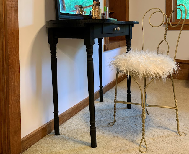 Black antique dressing table with gold vintage ice cream parlor chair makeover with white faux fur seat