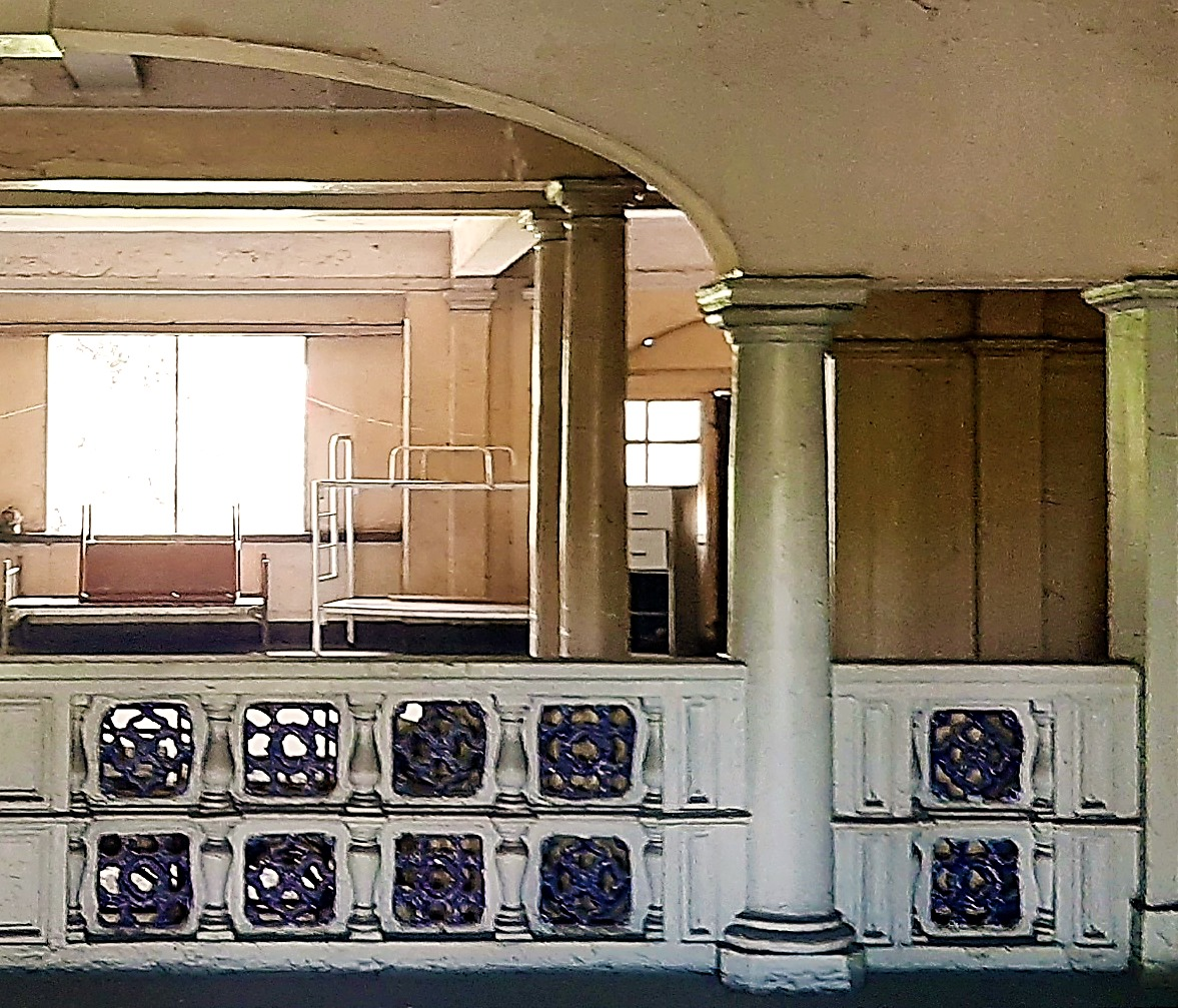 Typical detail of the balustrade overlooking the sala on upper levels, showcasing glazed ceramic detailing and classical columns