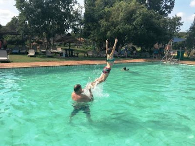 Jump in swimming pool in Dikhololo