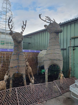 Two very large outdoor garden reindeer decorations.