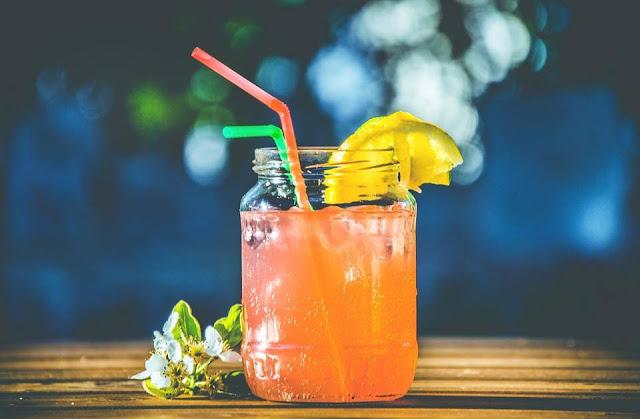 orange juice with straws
