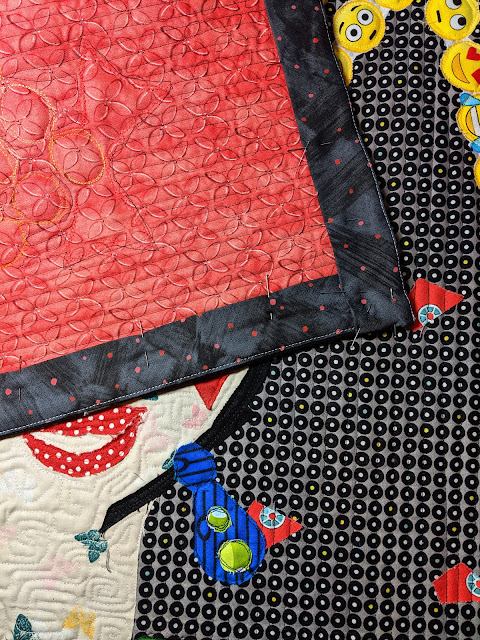 The dark grey facing on the Clara collage quilt hides all binding to the back.